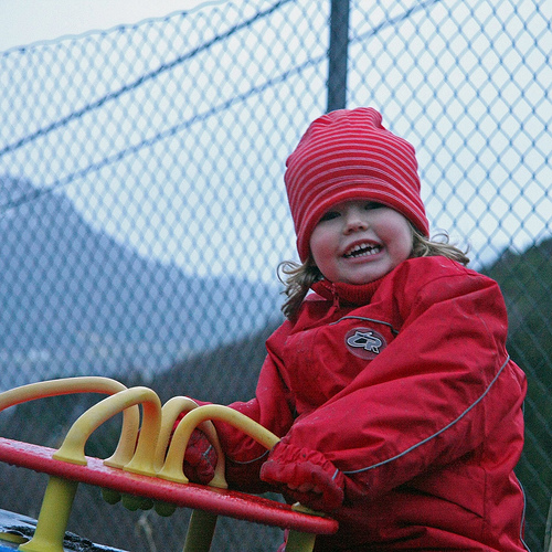Elin is having fun at the school playground with grandma.