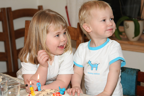 He is SO ready to blow the candles. (And so is his sister...)